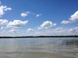 Lake with blue sky and white clouds